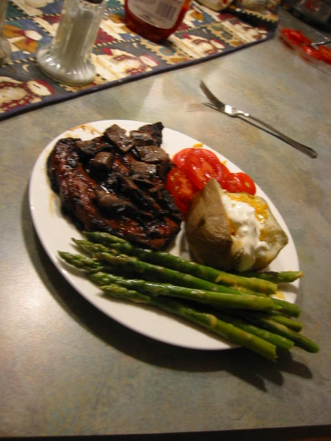 The ole standard:  Ribeye, asparagus, baked potato and tomatoes