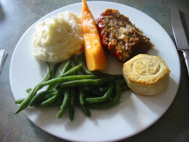 meatloaf, green beans, mashed potatoes, cantaloupe and roll