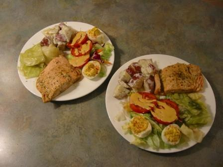 Poached salmon with boiled cabbage, deviled eggs, potatoes and salad