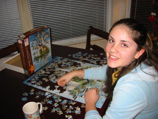 Lovely Daughter solving a puzzle